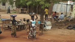 Video shots from a car to a market in Mali. Traveling in Africa, rallenty. Stock Footage