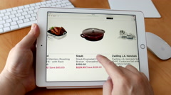 Close up man shopping cookware on ipad display Stock Footage