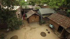 Woman washes her courtyard in Bengal, India. Wide shot, rotating Stock Footage