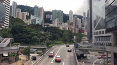 4K Time lapse traffic cityscape Hong Kong with skyscrapers. Extreme long shot. Stock Footage