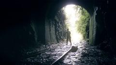 Woman walks along railways alone Stock Footage