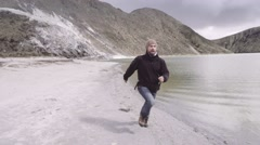 Man runs away from volcano Stock Footage