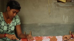 Young woman in India works on weaving a shawl - stock footage