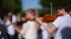 Out focus Slow motion of Kids play violin at outdoor performance group Stock Footage