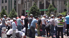 People are making Jumah praying on the street outside Dongguan Great Mosque. - stock footage