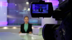 Young and beautiful girl reading news on television. News Studio. Stock Footage