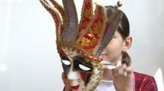 Girl trying on different masks Stock Footage