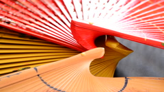 Traditional hand fans gyrating Stock Footage