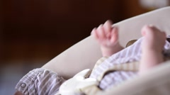 Hand of a newborn caucasian baby is in his car seat Stock Footage