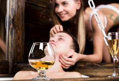 Young man and a naked woman in the bathroom. girl caresses the man's hair. close Stock Photos