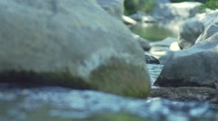 Megalithic stones in a river in slow motion water Stock Footage