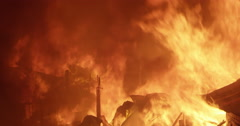 Intense flames in fire inferno in poor settlement Stock Footage