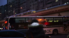People, crowd and transportation in downtown business area after work at night - stock footage