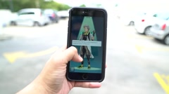 Iphone 6S Plus user playing Pokemon Go for the first time. Stock Footage