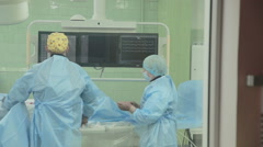 Unrecognizable Surgeons team performing operation in hospital operating room Stock Footage