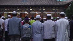 People are making Jumah prayer on the square in Dongguan Great Mosque - stock footage