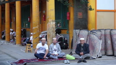 Muslims rest under the corridor in Dongguan Great Mosque. - stock footage