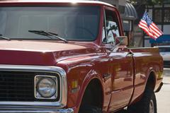 Retro american lifestyle - pickup truck and flag of the usa Stock Photos