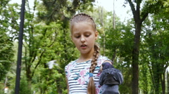 Pigeons sit on the girl's hand and peck feed - stock footage