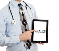 Doctor holding tablet - Vaccination Stock Photos