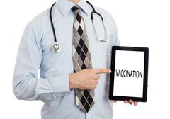 Doctor holding tablet - Vaccination - stock photo