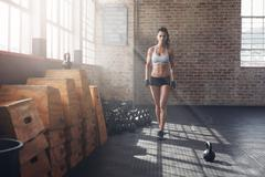 Young woman warming up before a intense workout - stock photo