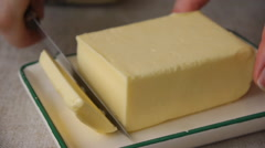 Cutting Off A Piece Of Butter Stock Footage