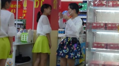 Chinese women's shopping mall promotion milk drink - stock footage