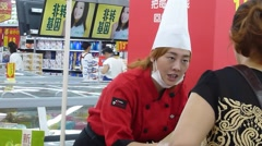 Women in the mall do Boiled dumplings promotional activities Stock Footage