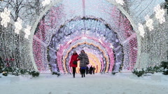 People and tourists walk along Moscow decorated for New Year and Christmas Stock Footage