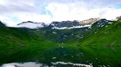 High mountain mirror lake timelapse Stock Footage