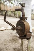 Old fashioned water pump Stock Photos