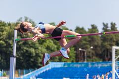 Young woman in highjump Kuvituskuvat