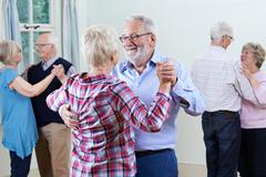 Group Of Seniors Enjoying Dancing Club Together Kuvituskuvat