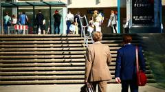 Rush hour traffic Commuter walking to Tram station Frankfurt am Main Germany Stock Footage