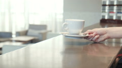 Smiling waitress placing a coffee on the counter - stock footage
