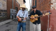 Two street musicians playing downtown Stock Footage