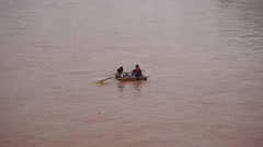 People sailing sheepskin raft on Yellow river Stock Footage