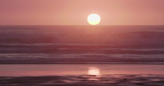 Sunset and ocean waves at piha, New Zealand Stock Footage