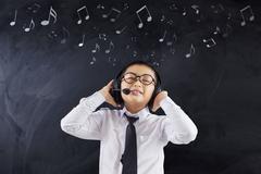 Student enjoy music with headphones Kuvituskuvat