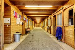 Large and authentic horse barn with many stalls. Northwest, USA - stock photo