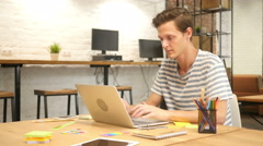 Celebrating Success, Excited and Joyous Man Working in Office on Laptop Stock Footage