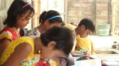 Boy and girl students diligently study in a village school in Bengal, India. Stock Footage