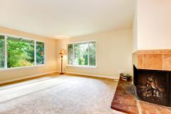 Nice airy family room with carpet floor, metal floor lamp and built in  firep Stock Photos