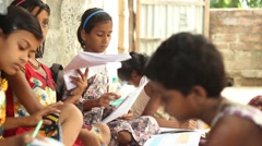 Boy and girl students stand, leaving others to continue to diligently study, Stock Footage