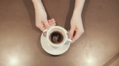 Waitress placing a coffee on the counter. top view Stock Footage