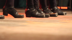 Women dancing Irish dance on stage in a folk festival Stock Footage