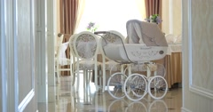 Amazing lace pram in white room Stock Footage