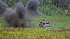 Old tank target on military firing range Stock Footage
