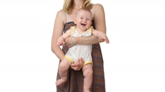 Mother shaking and swaying the baby - stock footage